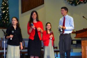 2015-11-29 Susanna, Priscilla, Phebe, Luke @ Carols Concert